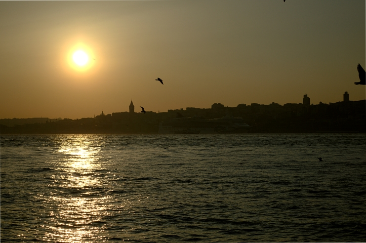 The Sun setting with Galata Tower visible on the skyline