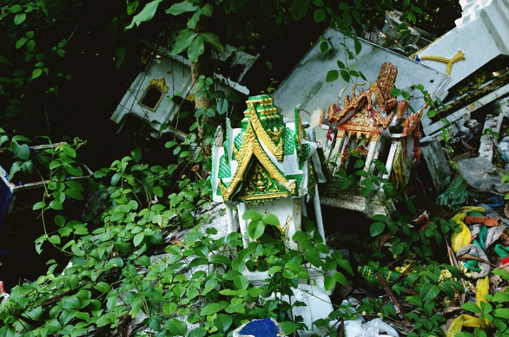 Discarded spirit houses by the side of the road